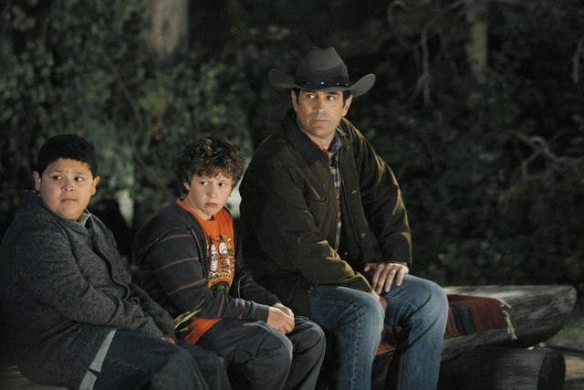 Rico Rodriguez as Manny, Nolan Gould as Luke, and Ty Burrell as Phil on Modern Family.  Photo copyright 2011 ABC, Inc.