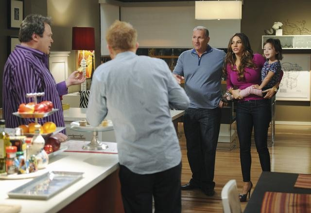 Eric Stonestreet as Cam, Jesse Tyler Ferguson as Mitchell, Ed O'Neill as Jay, and Sofia Vergara as Gloria on Modern Family.  Photo copyright 2011 ABC, Inc.
