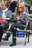 Isla Fisher caught up on messages in her street clothes.