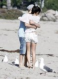 Justin and Selena hugged on the sand.