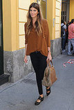 Bianca Brandolini D'Adda kept it minimal in a sienna button-up blouse and black skinnies.
