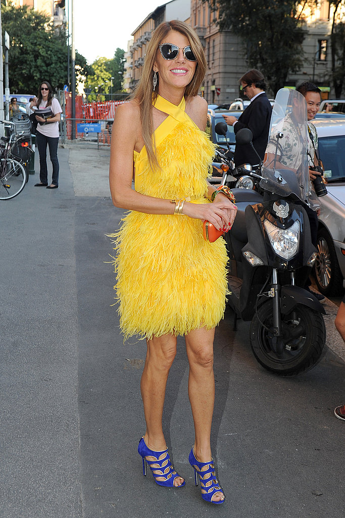 Anna Dello Russo worked in a feathery yellow frock and purple heels.