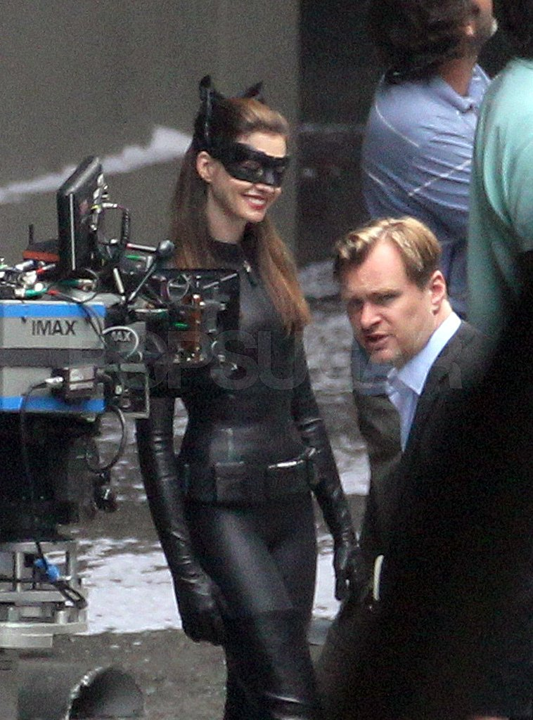 Anne Hathaway was all smiles chatting with director Christopher Nolan.