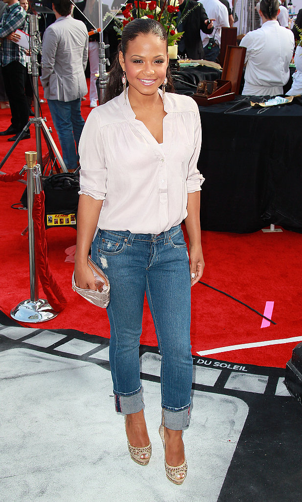 Christina Milian wore denim and classic white to Cirque du Soleil's Iris premiere.