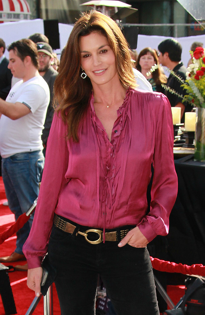 Cindy Crawford in a pink silk shirt.