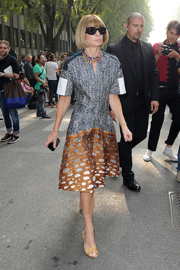 Anna Wintour on her way to Giorgio Armani wearing a printed drop-waist dress and peep-toe pumps.