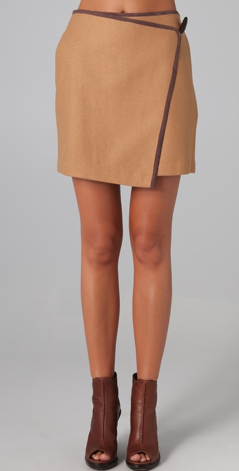 An asymmetrical wrap dress is warm tan hue. Madison Marcus Transfix Skirt with Leather Trim ($215)