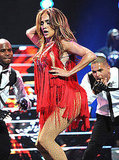 Jennifer Lopez looked hot in a red fringed dress while performing at the iHeartRadio music festival on Sept. 25.