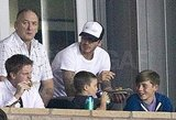The Beckhams snacked during the game.
