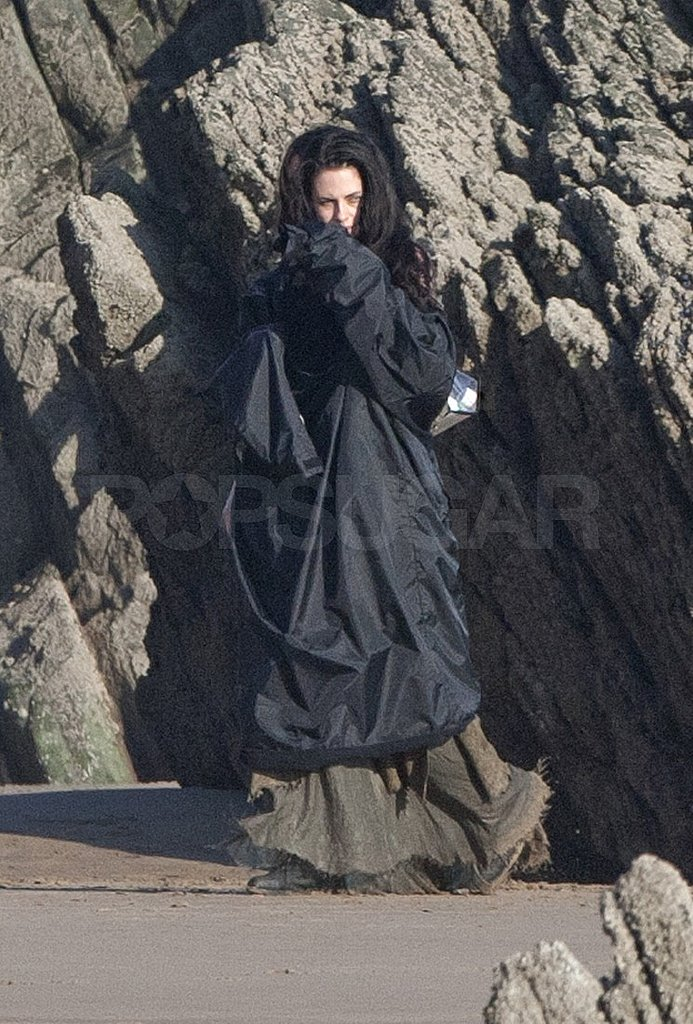 Kristen stayed warm between shots under a heavy jacket.