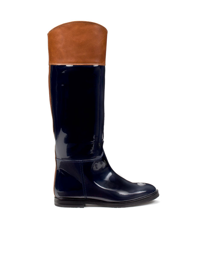 The classic riding boot with a slick patent update that will be super-chic with a pair of black skinnies tucked in.   Zara Patent Leather Boot ($90)
