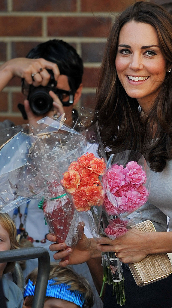 Kate smiles with her flowers.