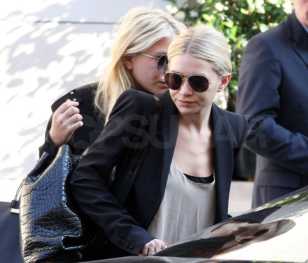 Mary-Kate and Ashley both wore dark sunglasses leaving a fashion show.