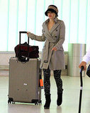 Rachel McAdams toted an oversized suitcase.