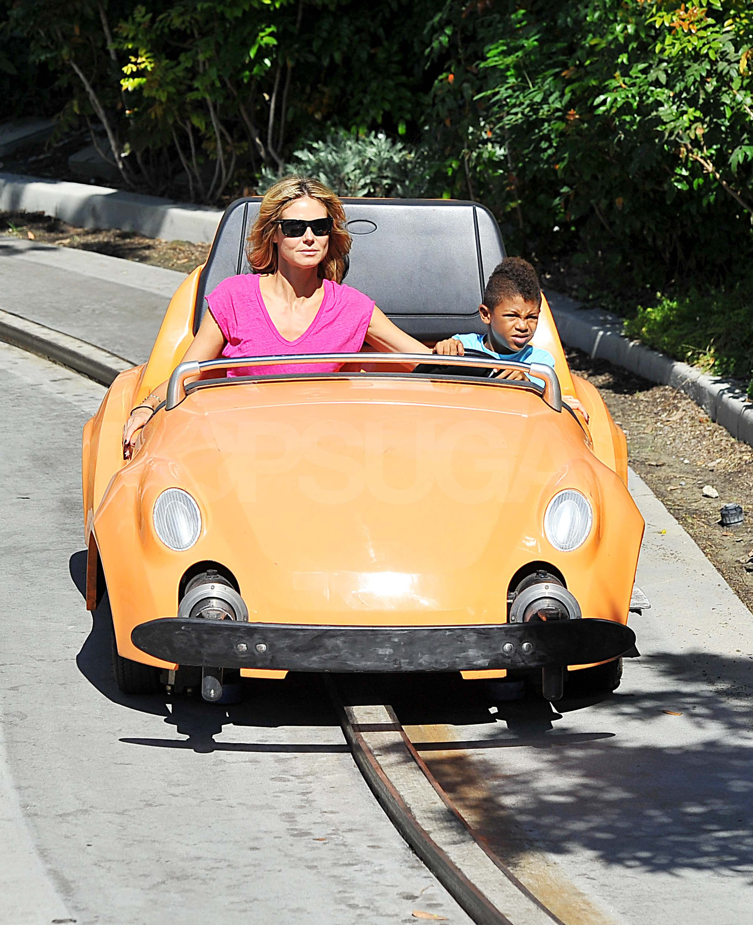 Heidi Klum and Henry driving cars at Disneyland. | Heidi ...