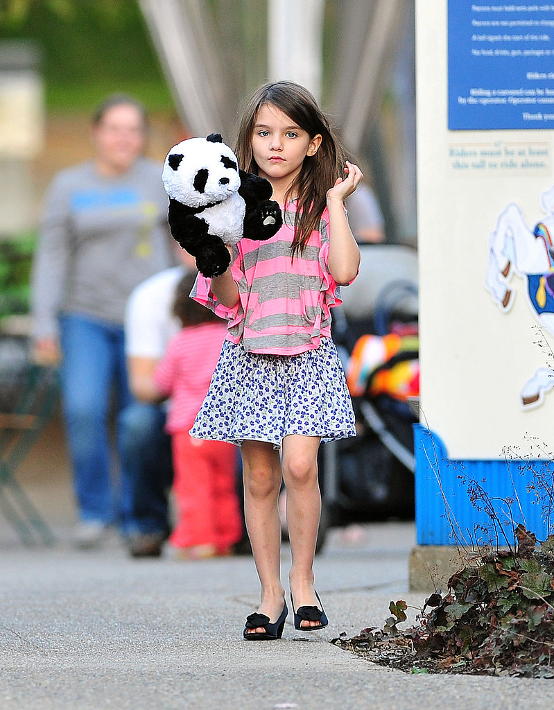 Suri Cruise held onto a stuffed panda bear on a walk with her parents.