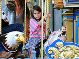 Suri Cruise rode a pig on a carousel in Pittsburg.