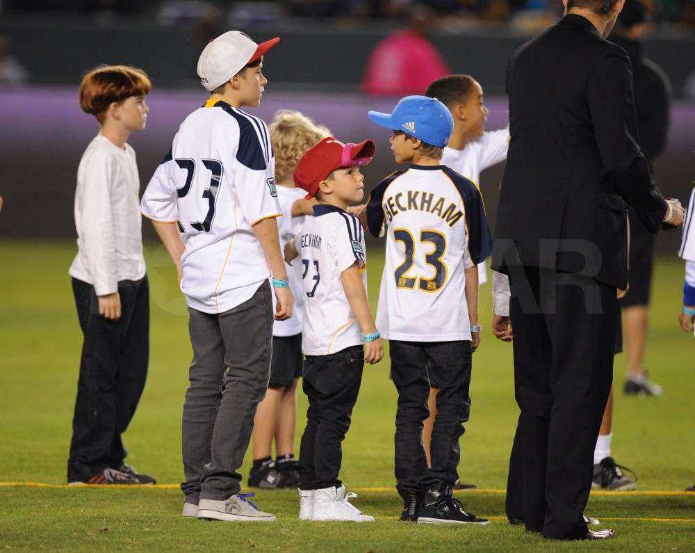 Brooklyn Beckham, Cruz Beckham, and Romeo Beckham stepped out on the field.