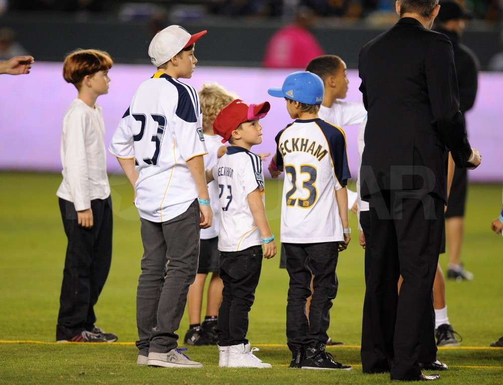Brooklyn Beckham, Romeo Beckham, and Cruz Beckham supported dad in jerseys with his number on them.
