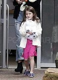 Suri Cruise wore purple sandals.