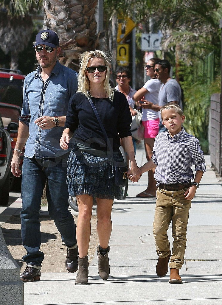 Reese Goes From Church in LA to Black Eyes and Tiny Shorts on Set in Little Rock