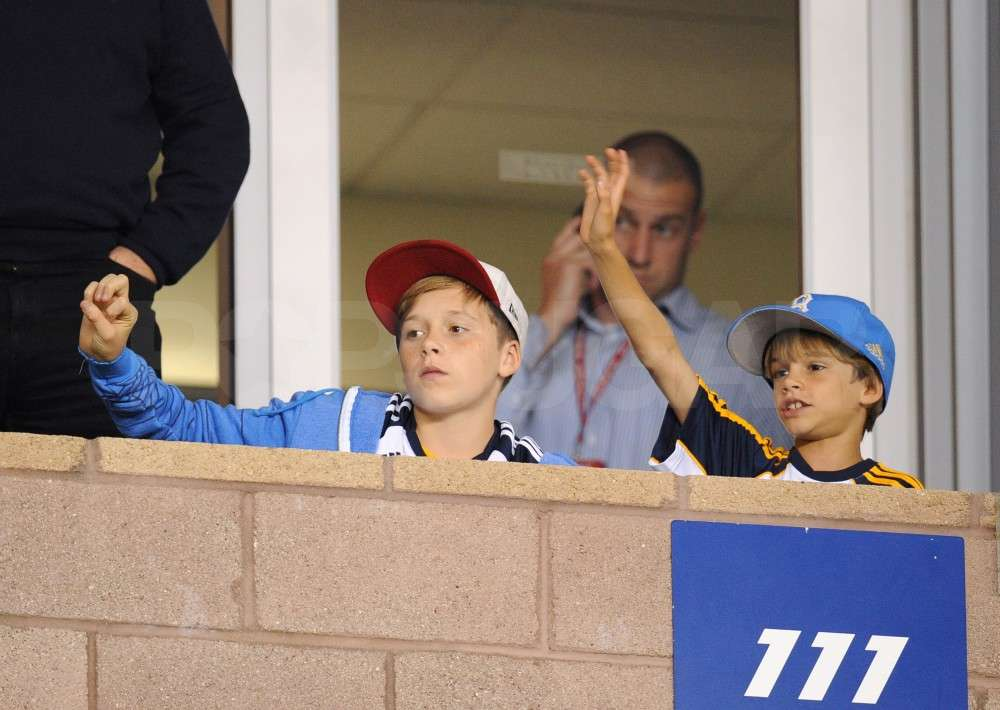 Cruz Beckham and Brooklyn Beckham cheered dad on from the stands.