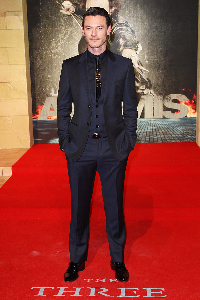 Luke Evans in a suit at the London premiere of The Three Musketeers.