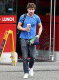 Shia LaBeouf kept his headphones in while walking to his bike.