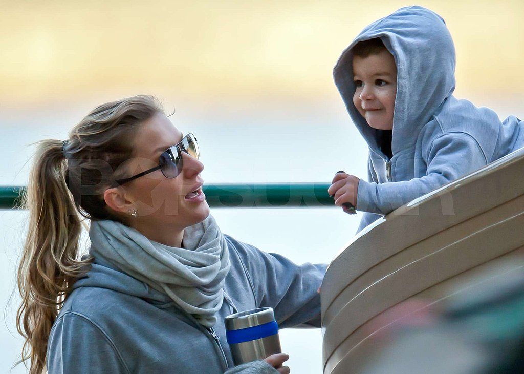 Gisele Bundchen gave Benjamin Brady a hand on the slide.