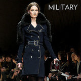 Why we love it: Military coats add a tough-girl vibe to our wardrobes; as evidenced by the Burberry Fall runway, they have that edgy statement power that commands attention. How to wear it: Treat your military coat like a wardrobe staple. Look for great details like a belt, buttons, and a double-breasted silhouette to speak to the trend. Just avoid too many overt utilitarian references in the rest of your outfit; it should come off as a cool accent piece – not look like you're actually suiting up in uniform.  Shop the runway: Burberry Double Breasted Wool Cashmere Trench Coat ($1,295)