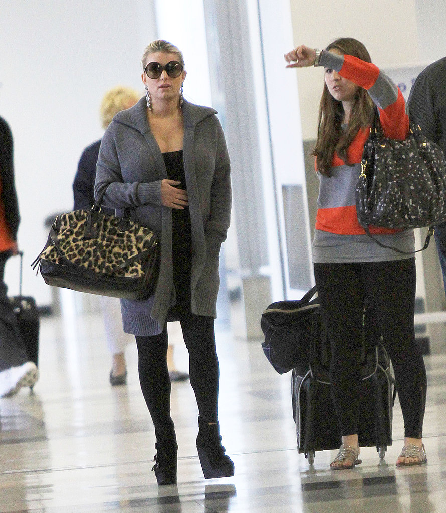 Jessica Simpson arrived at LAX in a gray sweater.