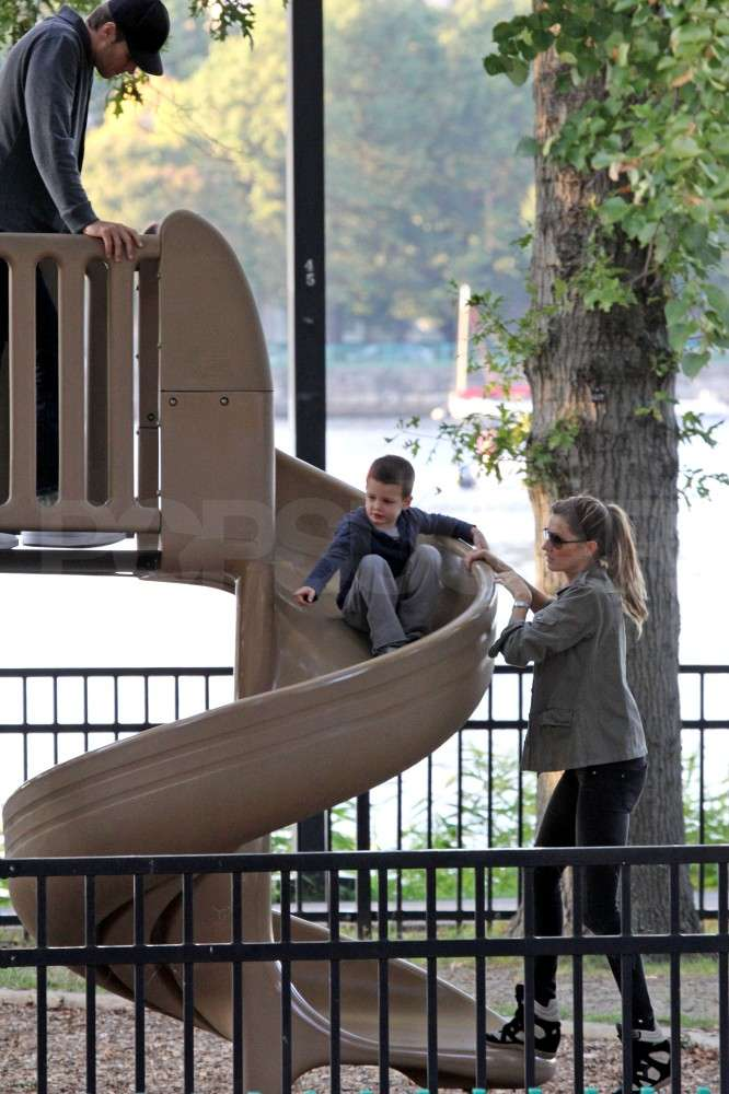 Tom Brady and Gisele Bundchen watched Jack Brady go down a slide.