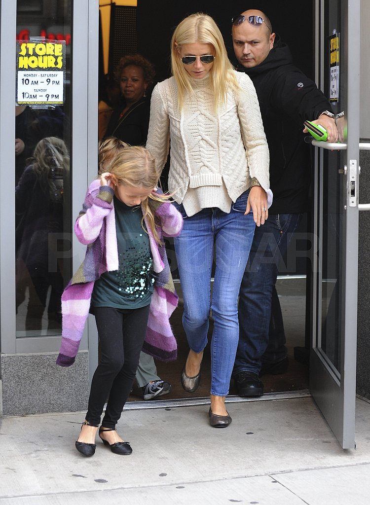 Apple Martin and Gwyneth Paltrow leave a Halloween shop.
