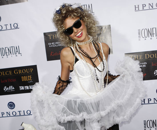 '80s Madonna We have to give Audrina Patridge props for going all out as the Material Girl for a red carpet bash.