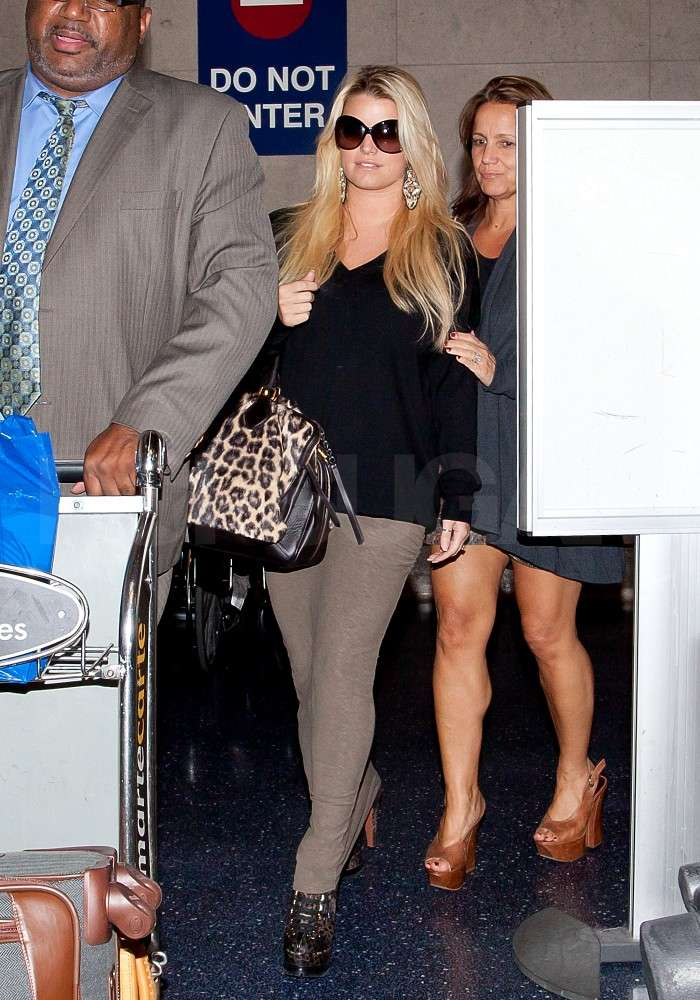 Tina showed off her legs while Jessica Simpson was covered up at LAX.