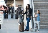 Courteney Cox pushed their luggage to the curb.