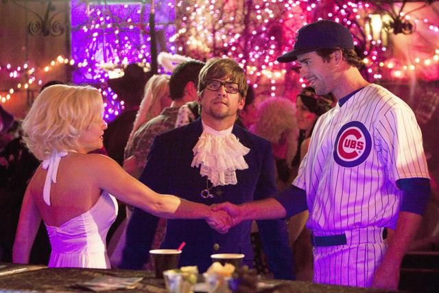 Ooh, looks like some ex awkwardness is bound to come up when Alex meets a cute new guy (David Walton) at the party.  Photo copyright 2011 ABC, Inc.