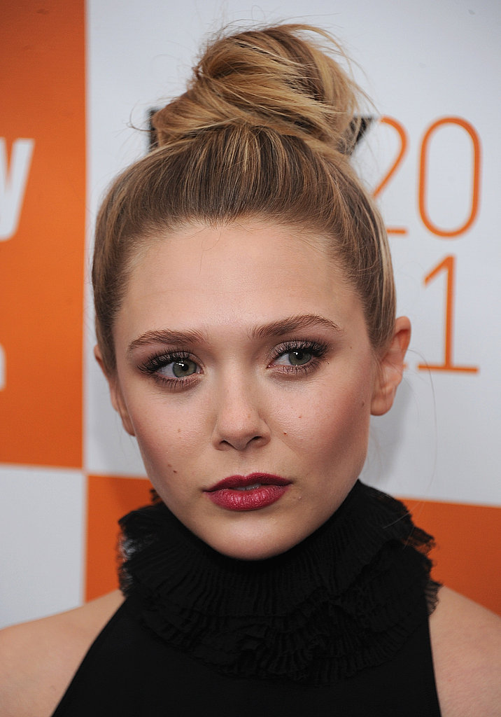 Elizabeth Olsen wore her hair in a bun.