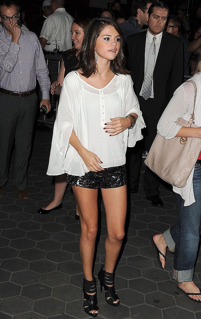 Selena Gomez in short shorts at the premiere of The Thing in LA.