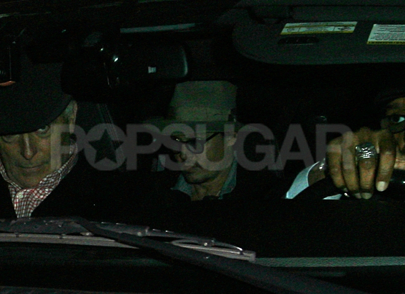 Johnny Depp wore a hat in the back seat of a car in LA.