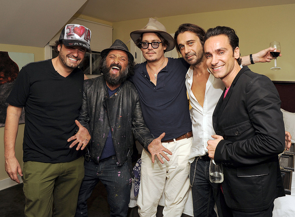Johnny Depp with artists Domingo Zapata, Dr. Brainwash, Jordi Molla, and Antonio Del Prete at an opening in LA.