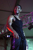 Usher beat the Summer heat in a tight black tank top while performing at the Thisday Africa Rising Festival in July 2008.