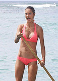 Alessandra Ambrosio paddle boards in Hawaii in a bikini.