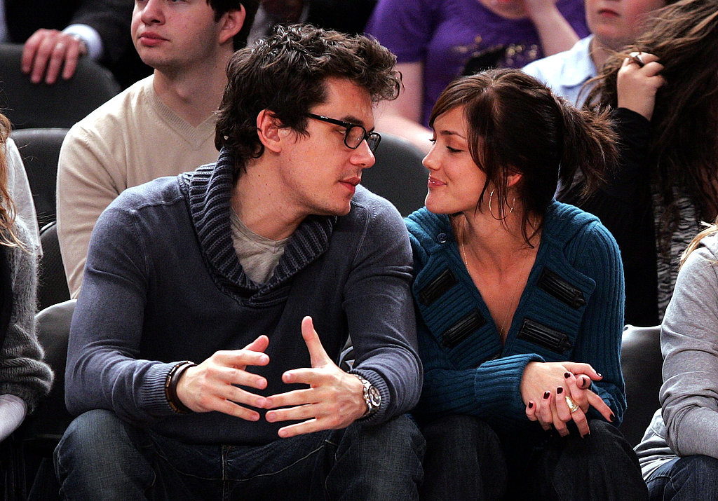 John Mayer carried on a close conversation with Minka Kelly during a NY Knicks home game in November 2007.