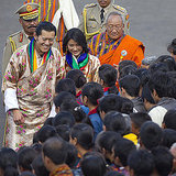 King Jigme Khesar Namgyel Wangchuck and Queen Ashi Jetsun Pema talk with the crowd.