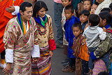 King Jigme Khesar Namgyel Wangchuck and Queen Ashi Jetsun Pema greet the crowds.