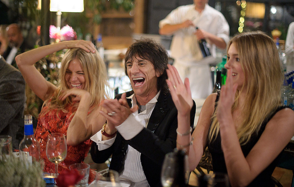 Sienna Miller, Ronnie Wood, and Lily Donaldson hang out at the end of dinner.