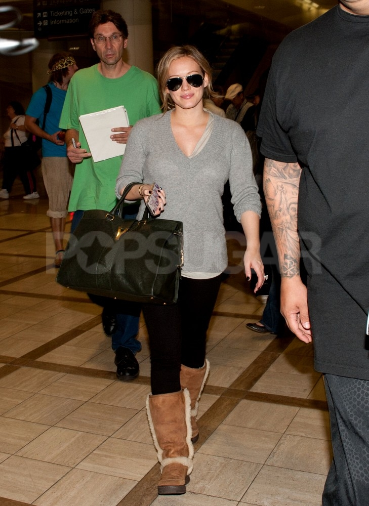 Pregnant Hilary Duff looked happy and healthy at LAX.
