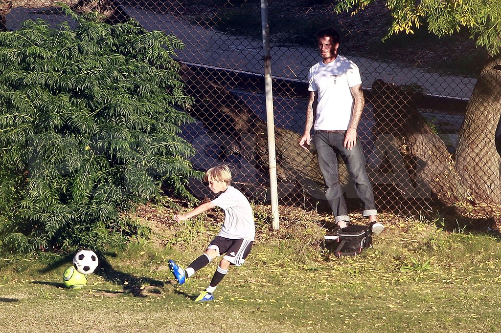 David Beckham watched his son play soccer.
