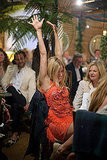 Sienna Miller threw her hands in the air at a dinner party.